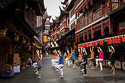 Elderly women practice Tai Chi in Yu Yuan Gardens bazaar Shanghai, China