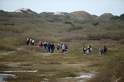 Visitors walk out to get a closer look at elephant seals on the beaches of Ano Nuevo State Park in Pescadero, Calif., Friday, March 3, 2017, where the breeding season for Earth's largest pinnipeds is winding down. (Photo by D. Ross Cameron)