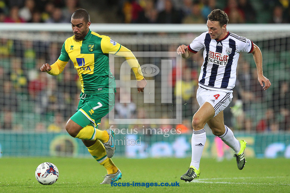 Lewis Grabban of Norwich and James Chester of West Bromwich Albion in action during the Capital One Cup match at Carrow Road, Norwich<br /> Picture by Paul Chesterton/Focus Images Ltd +44 7904 640267<br /> 23/09/2015