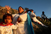 A healer and follower of Ni?o Fidencio, a curandero or healer who passed away in the 1938, conducts a healing session on top of a hill just outside of Espinazo, Mexico on October 18, 2006. Followers of Nino Fidencio believe that his spirit can posses other healers, who once possessed speak in a child like voice and perform a variety of medical cures on their followers. His believers, an estimated 20,000, gather in his hometown for a three-day festival twice a year in March and October. (Photo/Scott Dalton)