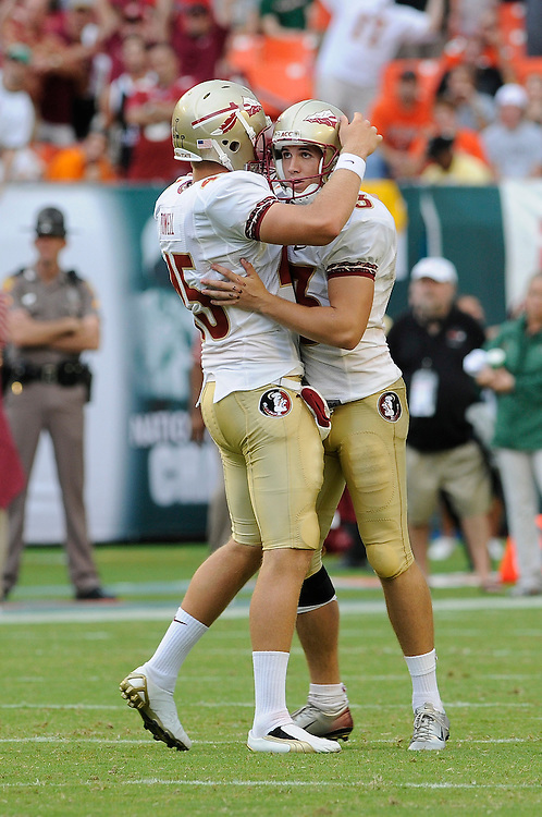 October 4, 2008 - Miami Gardens, FL<br /> <br /> Florida State University kicker Graham Gano gets a hug from holder  Shawn Powell after kicking a field goal during the Seminoles 41-39 victory over the Miami Hurricanes at Dolphin Stadium in Miami Gardens, Florida.<br /> <br /> JC Ridley/CSM