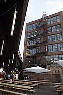New York , bar under the high line, in  Chelsea , The High Line is a 1.45-mile (2.33 km) section of the former elevated freight railroad of the West Side Line, along the lower west side of Manhattan, which has been redesigned and planted as a greenway.
