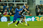 Joelinton (#9) of Newcastle United fails to defend the ball against the challenge of Ngolo Kante (#7) of Chelsea during the Premier League match between Newcastle United and Chelsea at St. James's Park, Newcastle, England on 18 January 2020.
