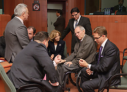 Wolfgang Schaeuble, Germany's finance minister, center, speaks with (from left) Jan Kees De Jager, the Netherlands's finance minister, Giulio Tremonti, Italy's finance minister, Josef Proell, Austria's finance minister, Elena Salgado, Spain's finance minister, Tonio Fenech, Malta's finance minister, standing, and Jyrki Katainen, Finland's finance minister, far right, during a meeting of the Eurogroup finance ministers at the EU Council headquarters in Brussels, Monday, Dec. 6, 2010. (Photo © Jock Fistick)