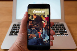 Detail of German internet dating website app Neu.de on a iPhone Plus smart phone
