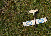 A wooden airplane lays in the grass close to the Astoria Tower in August of 2013 in Astoria, Oregon.