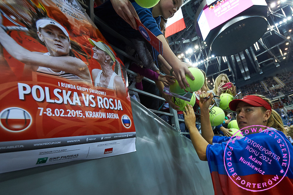 Maria Sharapova from Russia signs autograph after her winning game during Second Day of the Fed Cup / World Group 1st round tennis match between Poland and Russia at Tauron Krakow Arena on February 8, 2015 in Cracow, Poland.<br /> <br /> Poland, Cracow, February 8, 2015<br /> <br /> Picture also available in RAW (NEF) or TIFF format on special request.<br /> <br /> For editorial use only. Any commercial or promotional use requires permission.<br /> <br /> Adam Nurkiewicz declares that he has no rights to the image of people at the photographs of his authorship.<br /> <br /> Mandatory credit:<br /> Photo by &copy; Adam Nurkiewicz / Mediasport