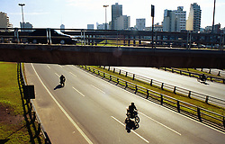BUENOS AIRES, ARGENTINA: Motorist travelon highways and overpasses in Buenos Aires, Argentina. .(Photo by Ami Vitale)