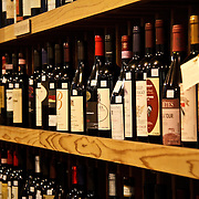 Wine bottles on shelves, DeLaurenti Import food store, Pike Place Market, Seattle, Washington