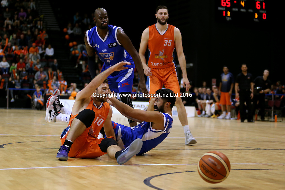 Mitch Norton (L) of the Sharks and Damian Ekenasio of the Saints compete for the ball in the NBL basketball match between the Southland Sharks and Wellington Saints, ILT Stadium Southland, Invercargill, Sunday, May 22, 2016. Photo: Dianne Manson / www.photosport.nz