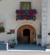 Decorated doe and window frame, Photographed in Brail, a municipality in the Maloja Region in the Swiss canton of Graubünden. in the Inn Valley