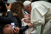 Pope Francis Blesses the sick at the end of his weekly general audience at the Paul VI audience hall on December 13, 2017 at the Vatican.