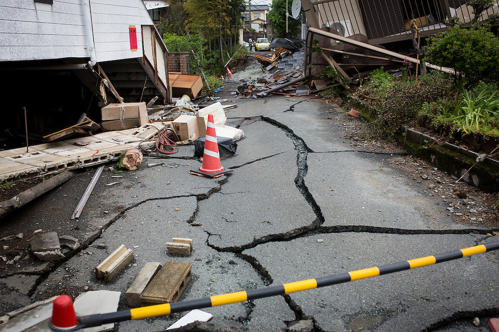 KUMAMOTO, JAPAN - APRIL 22:  A crack road is seen through the wreckage of houses on April 22, 2016 in Mashiki town, Kumamoto, Japan. To date 48 people are confirmed dead and more than 80,000 people have evacuated after an 6.5 earthquake on Thursday night and a stronger 7.3 quake on Saturday morning struck the Kyushu Island in western Japan.<br /> <br /> Photo: Richard Atrero de Guzman