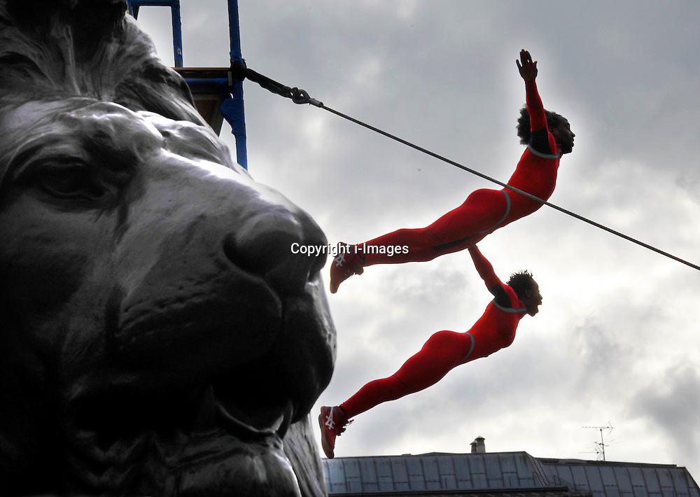 Members of the Streb extreme action dancers  perform the 'Human Fountain' jumping from a scaffold  in Trafalgar Square, London,  Sunday, 15th July 2012  Photo by Andre Camara /  i-Images