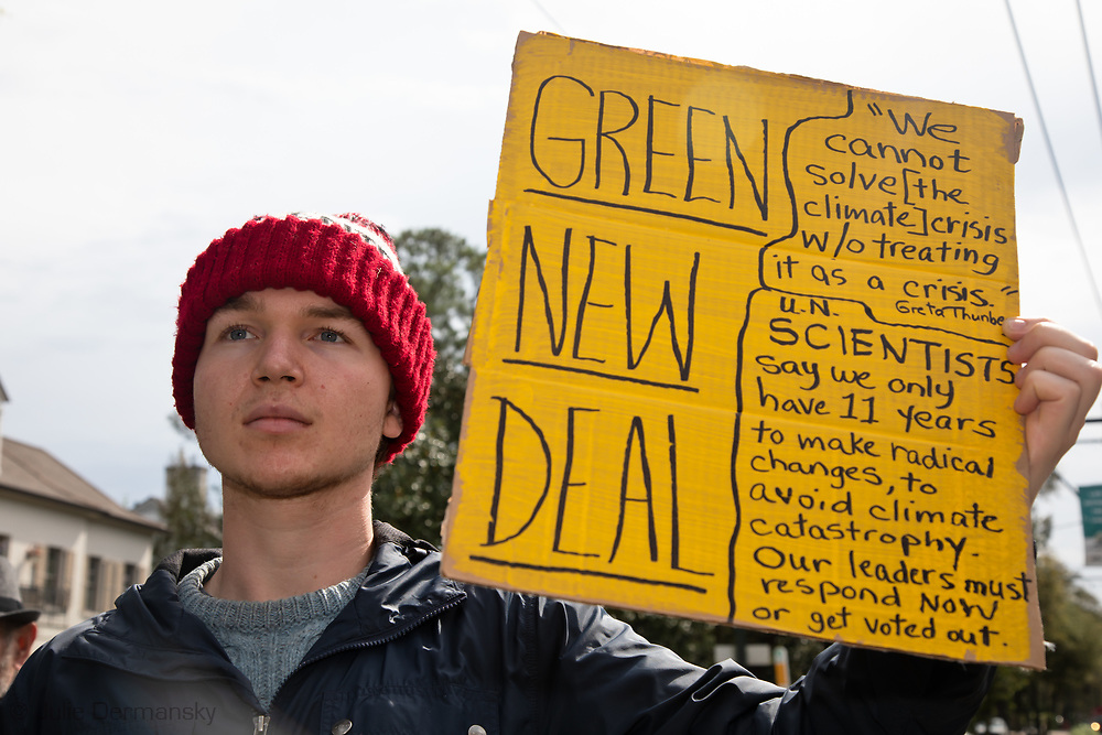 "Chase O'Halloran, a Loyola college student, worries about the lack of urgency of New Orleans residents toward climate change. ""Regardless of what we are working for whether it be a career or a degree, or high school, none of that exists without climate,"" he said. He wonders what it is going to take for people to put two and two together and realize the threat of climate change is universal."