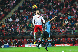 November 10, 2017 - Warsaw, Poland - Jakub Blaszczykowski (POL), Giorgian de Arrascaeta (URU) in action during the international friendly match between Poland and Uruguay at National Stadium on November 10, 2017 in Warsaw, Poland. (Credit Image: © Foto Olimpik/NurPhoto via ZUMA Press)