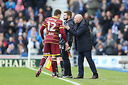 Queens Park Rangers striker Jamie Mackie (12) receives instructions from Queens Park Rangers manager Ian Holloway during the EFL Sky Bet Championship match between Brighton and Hove Albion and Queens Park Rangers at the American Express Community Stadium, Brighton and Hove, England on 27 December 2016.