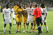 Jimmy Tau tries to calm things down between Mogogi Gabonamong and the Santos players and referee Harry Lekitlane during the PSL match between Santos and Kaizer Chiefs held at The Nelson Mandela Bay Stadium in Port Elizabeth, Eastern Cape South Africa on 20 November 2009 ..Photo by RG/www.sportzpics.net.+27 21 (0) 21 785 6814