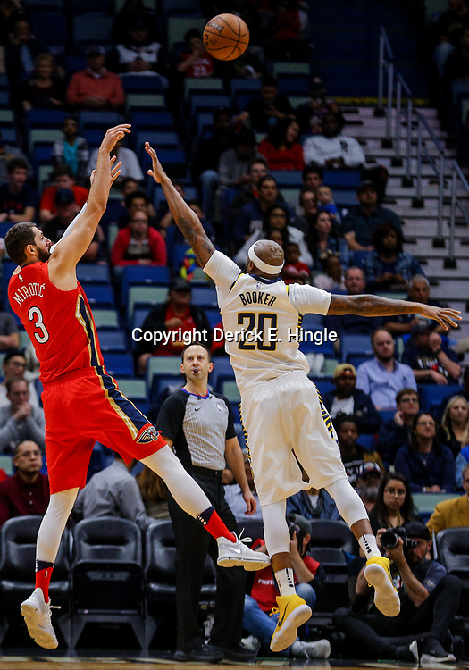 Mar 21, 2018; New Orleans, LA, USA; New Orleans Pelicans forward Nikola Mirotic (3) shoots over Indiana Pacers forward Trevor Booker (20) during the first quarter at the Smoothie King Center. Mandatory Credit: Derick E. Hingle-USA TODAY Sports