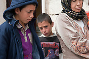 Hamzi (middle) is a 9 years old boy who got wounded in the face after he fell down because of the blast of an exploding shell..He makes part of a family of Syrian refugees who arrived exhausted on March 10th, 2012 in the village El Fakha, Lebanon, after a bombardment on March 9th, 2012 which destroyed their house in Zahra.
