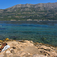 Shoes on Cliff Overlooking Peljesac Strait in Korčula, Croatia <br />