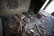 Interior of a blighted house in the lower 9th ward  that remains standing almost six year after Hurricane Katrina with dolls and dried mud on the floors. As the six year anniversary of Hurricane Katrina nears  blight remains in New Orleans. Many of the programs to remove blight and help the city recover are federally funded and will face cuts because of the economic decline.