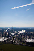 Nederland, Limburg, Gemeente Sittard-Geleen., 07-03-2010; Chemelot,  complex voor chemische industrie in westelijke mijnstreek, huisvest onder andere DSM (De Staatsmijnen, Dutch State Mines). Voormalige terrein van de Staatsmijn Maurits. Stoom en rook ontsnapt aan koeltorens en schoorstenen..Chemelot complex for chemical industry in former western mining district, home to DSM (Dutch State Mines). Former site of mine Maurice. Steam and smoke escapes from cooling towers and chimneys..luchtfoto (toeslag), aerial photo (additional fee required).foto/photo Siebe Swart