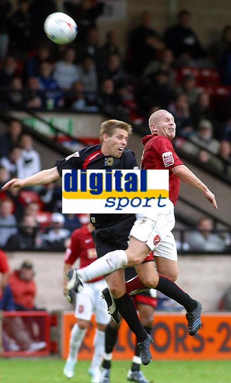 Photo: Dave Linney.<br />Walsall v Milton Keynes Dons. Coca Cola League 2. 28/10/2006. Walsall's (R) flicks on the ball past Gareth Edds