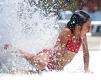 Amber Sanchez, 9, plays in the water spouts at Dry Town Water Park in Palmdale Wednesday.  KELLY LACEFIELD/Valley Press Jun 20, 2007