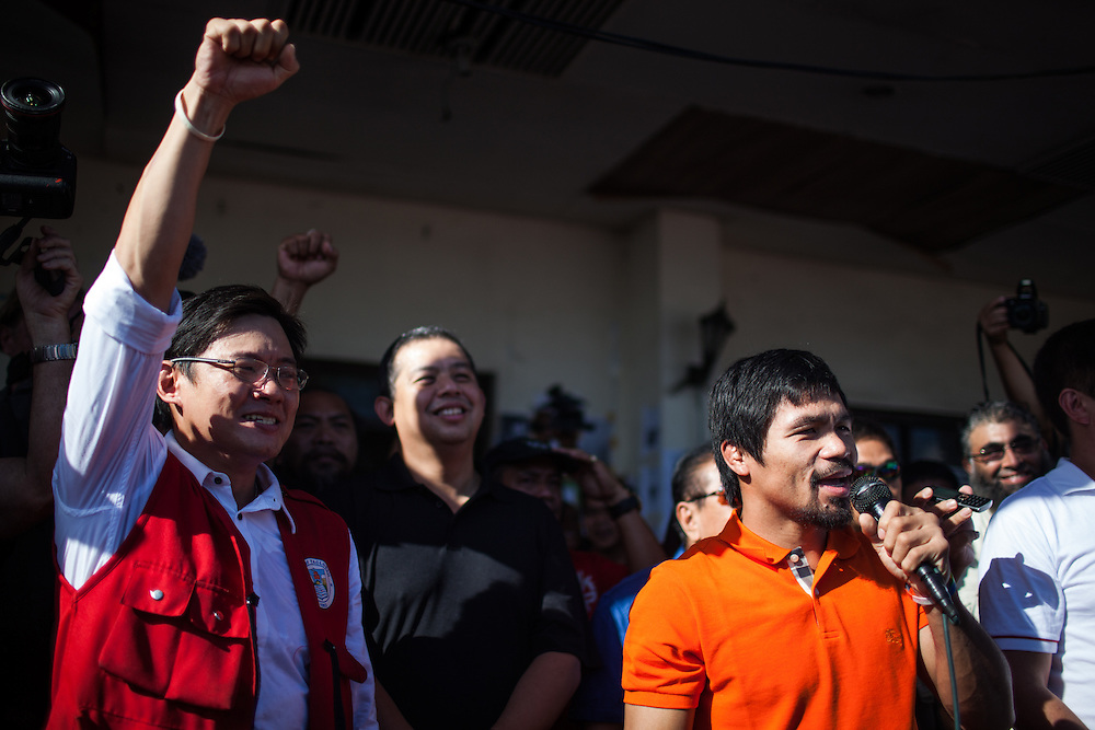 Manny Pacquaio addresses the public at Tacloban City Hall during his visit.  <br /> <br /> Manny Pacquaio visits victims of Typhoon Yolanda in Tacloban City.  Leyte, Philippines  December 2, 2013