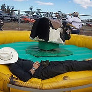A cowboy rests near the bull ride machine during the Branxton Rodeo at Branxton, Hunter Valley,  New South Wales, Australia, on Saturday 17th October 2009.  Photo Tim Clayton.