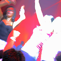 Silhouette of people dancing on a dance floor at a night club