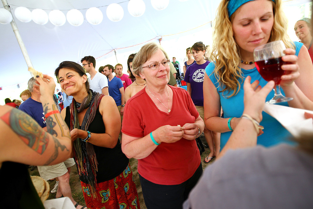 Festival attendees participate in communion in the Bluegrass Liturgy at the Wild Goose Festival at Shakori Hills in North Carolina June 25, 2011.  (Photo by Courtney Perry)