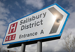 © Licensed to London News Pictures. 06/03/2018. Salisbury, UK. A road sign pints to the entrance of Salisbury District hospital where former Russian spy Sergei Skripal and his daughter were taken after becoming ill with suspected poisoning. The couple where found unconscious on bench in Salisbury shopping centre. Specialist units have been called in to deal with any possible contamination. Photo credit: Peter Macdiarmid/LNP