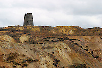 Great Opencast & Summit Windmill at Parys Mountain (Mynydd Trysglwyn) copper mine, Anglesey Wales. First mined in the  Bronze Age extraction was at its peak in the 18th & 19th centuries. ....