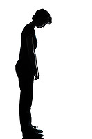 one caucasian young teenager silhouette girl sad looking down  full length in studio cut out isolated on white background