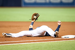July 8, 2017 - St. Petersburg, Florida, U.S. - WILL VRAGOVIC   |   Times.Tampa Bay Rays first baseman Logan Morrison (7) after stretching to catch the throw from third baseman Evan Longoria (3) on the single by Boston Red Sox shortstop Xander Bogaerts (2) in the first inning of the game between the Boston Red Sox and the Tampa Bay Rays at Tropicana Field in St. Petersburg, Fla. on Saturday, July 8, 2017. (Credit Image: © Will Vragovic/Tampa Bay Times via ZUMA Wire)