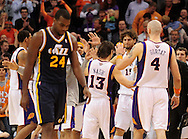 Feb. 15, 2011; Phoenix, AZ, USA; Phoenix Suns guard Steve Nash (13) and teammate Marcin Gortat (4) are congratulated by teammates as Utah Jazz forward Paul Millsap reacts at the US Airways Center. The Suns defeated the Jazz 102-101. Mandatory Credit: Jennifer Stewart-US PRESSWIRE