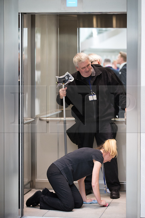 © Licensed to London News Pictures . 14/11/2013 . Manchester , UK . The lift allocated to the royal party is cleaned and polished ahead of the visit . Queen Elizabeth II and the Duke of Edinburgh visit the Coop building at 1 Angel Square , Manchester , this morning ( 14th November 2013 ) . Photo credit : Joel Goodman/LNP