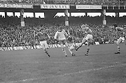 Kerry makes a kick while Tyrone blocks it with his leg during the All Ireland Minor Gaelic Football Final, Tyrone v Kerry in Croke Park on the 28th September 1975.