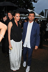 SASHA VOLKOVA and DAN MACMILLAN at the annual Serpentine Gallery Summer Party sponsored by Burberry held at the Serpentine Gallery, Kensington Gardens, London on 28th June 2011.