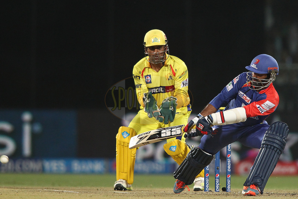 Dinesh Karthik of the Delhi Daredevils reverse sweeps a delivery during match 26 of the Pepsi Indian Premier League Season 2014 between the Delhi Daredevils and the Chennai Super Kings held at the Feroze Shah Kotla cricket stadium, Delhi, India on the 5th May  2014<br /> <br /> Photo by Shaun Roy / IPL / SPORTZPICS<br /> <br /> <br /> <br /> Image use subject to terms and conditions which can be found here:  http://sportzpics.photoshelter.com/gallery/Pepsi-IPL-Image-terms-and-conditions/G00004VW1IVJ.gB0/C0000TScjhBM6ikg