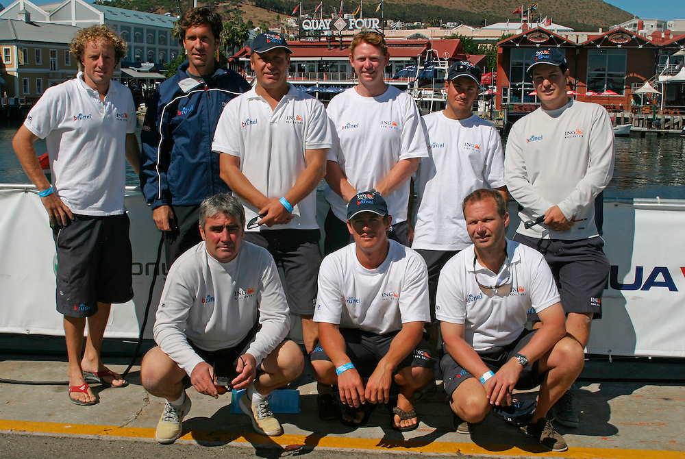 "Volvo Ocean Race 2005-2006. Stopover number 1 - Cape Town, South Africa. Shore preparations..The Australian entry ""ING Real Estate Brunel"".Crew for inport race, 26/12/05..back row, l to r: Ben Jones (AUS), Ian Ainsley (RSA), Barnie Walker (AUS), Fraser Brown (NZL), Mark Bartlett (GBR), Mark Fullerton (AUS). Front row, l to r: Jeff Scott (NZL), Adam Hawkins (AUS), Gideon Messink (NED)"
