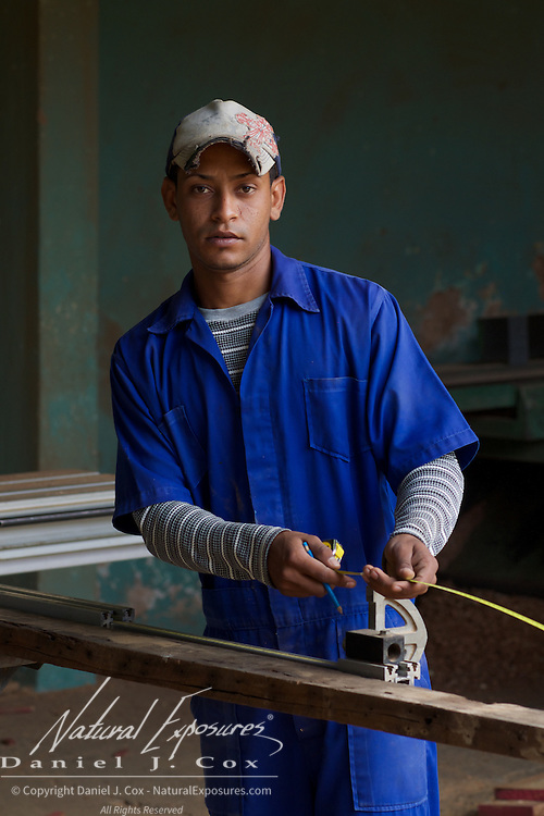 A young man working in a local saw mill in Trinidad, Cuba,