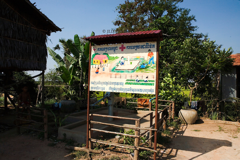 Tonle Sap lake : enroute to Khampon Khleang, illustrated instructional sign about safe water and irrigation, with a Red Cross symbol.   The pictures urge separating potable and irrigation water.