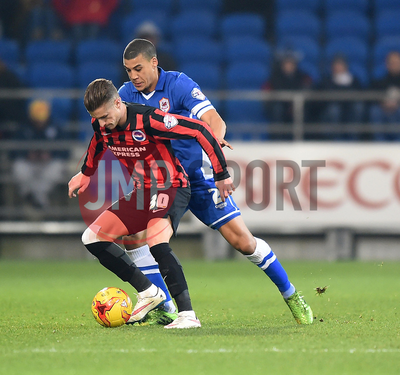 Brighton and Hove Albion's Kemy Agustien fends off Cardiff City's Lee Peltier - Photo mandatory by-line: Paul Knight/JMP - Mobile: 07966 386802 - 10/02/2015 - SPORT - Football - Cardiff - Cardiff City Stadium - Cardiff City v Brighton & Hove Albion - Sky Bet Championship