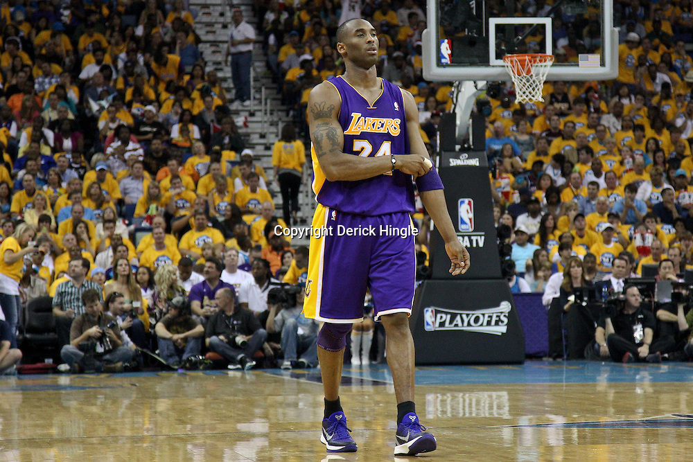 April 22, 2011; New Orleans, LA, USA; Los Angeles Lakers shooting guard Kobe Bryant (24) against the New Orleans Hornets during the second quarter in game three of the first round of the 2011 NBA playoffs at the New Orleans Arena.    Mandatory Credit: Derick E. Hingle