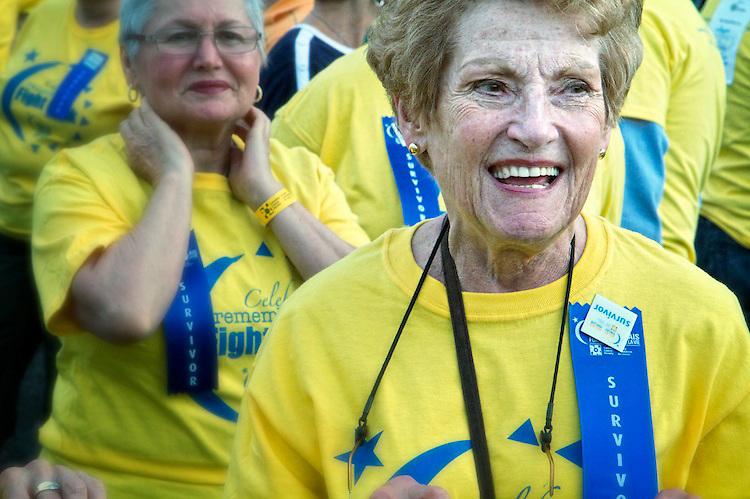 A smiling cancer survivor enjoys the Survivor's Lap during the Relay for Life 2010 Central Toronto.