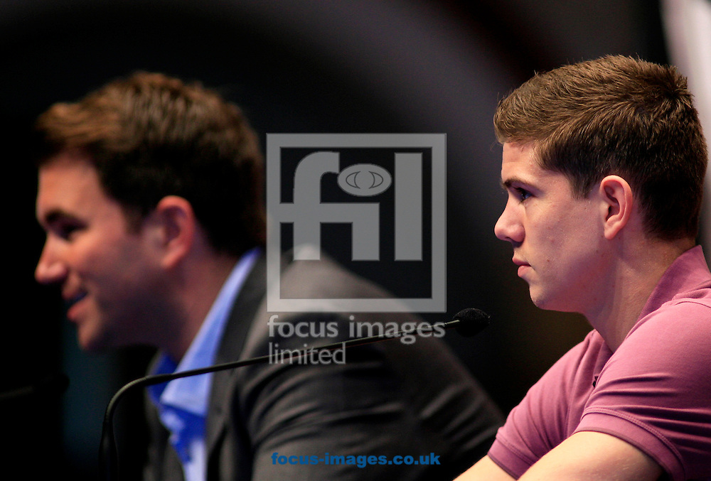 Picture by Richard Gould/Focus Images Ltd +447814 482222.24/04/2013.Luke Campbell listens as his promoter talks at his Press Conference at Hull City Hall, Hull.