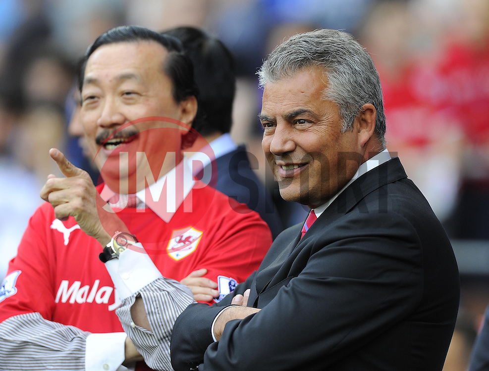 Cardiff City owner, Tan Sri Vincent Tan (left) shares a joke with Cardiff City Chairman, Mehmet Dalman  - Photo mandatory by-line: Joe Meredith/JMP - Tel: Mobile: 07966 386802 25/08/2013 - SPORT - FOOTBALL - Cardiff City Stadium - Cardiff -  Cardiff City V Manchester City - Barclays Premier League